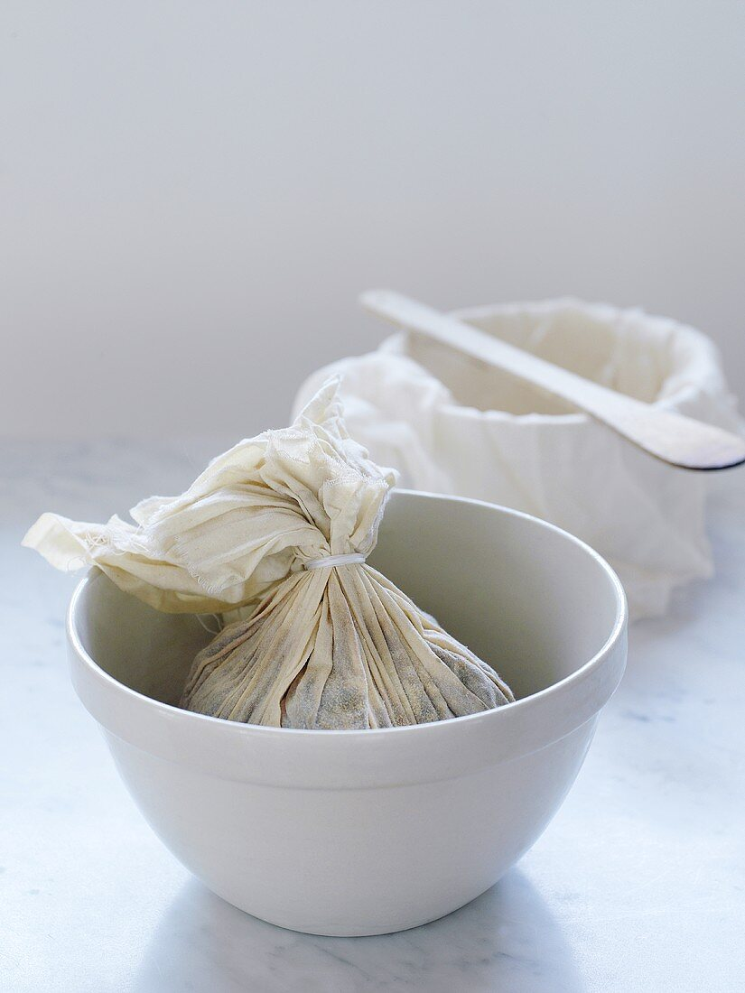 Christmas pudding wrapped in a cloth in a basin