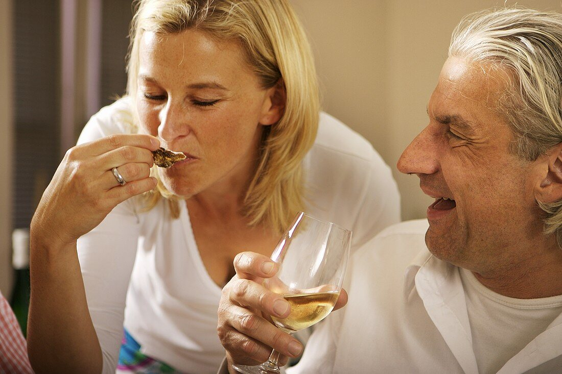 Blond woman and grey-haired man at a party