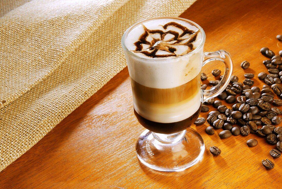 Wiener Melange (Viennese coffee speciality) in glass cup