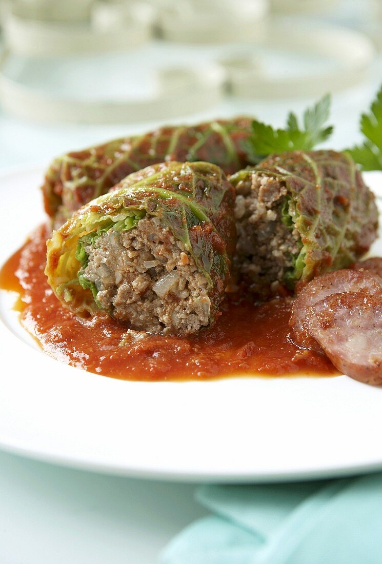 Savoy cabbage leaves stuffed with mince, with tomato sauce