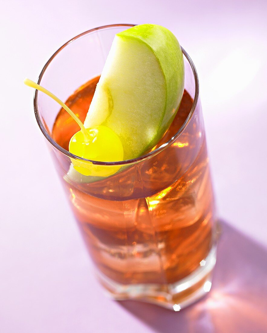 Cocktail made with whisky, apple juice, melon liqueur & grenadine