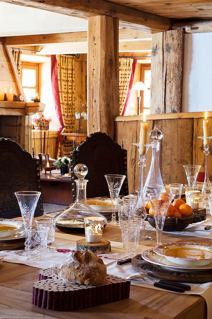 Laid table with fine glasses in an Alpine chalet