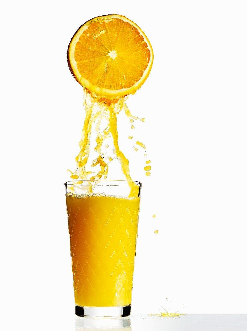 Orange juice with half an orange