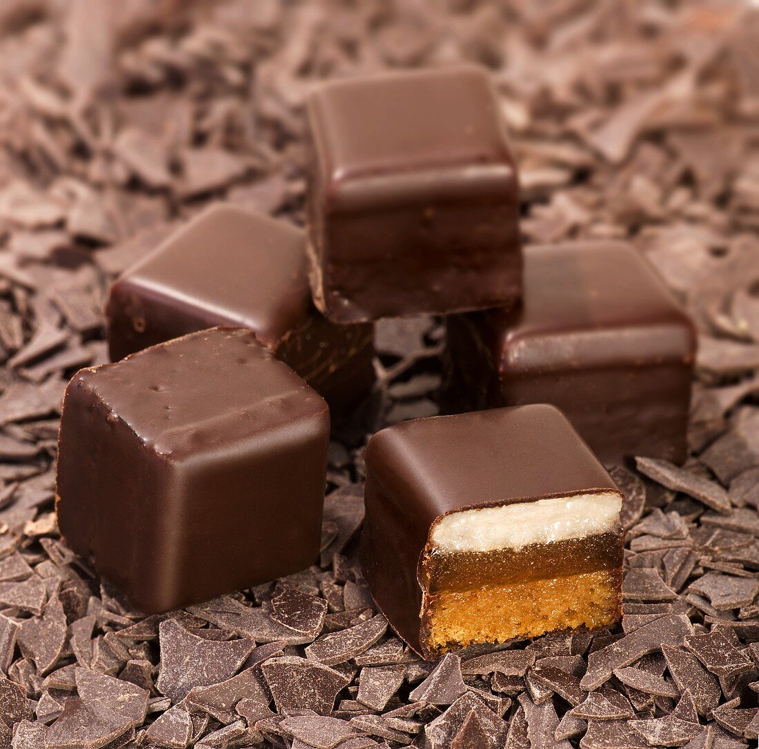 Several Dominosteine (Dominoes, layered chocolate-coated sweets)