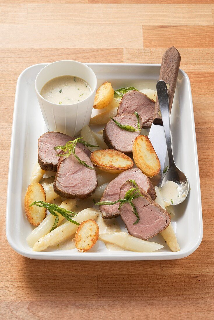 Veal fillet with tarragon & mustard sauce and asparagus