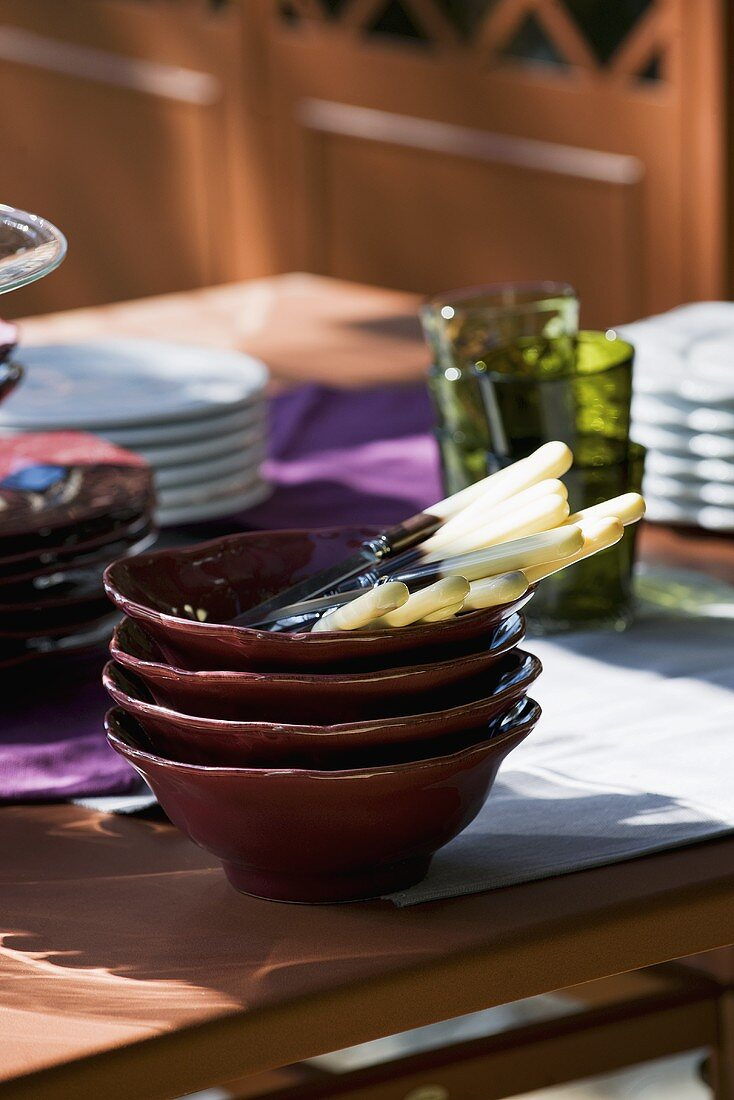Crockery, cutlery and glasses on table (Italy)