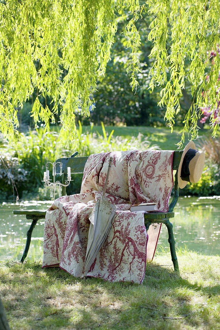 Romantic garden seat by pond