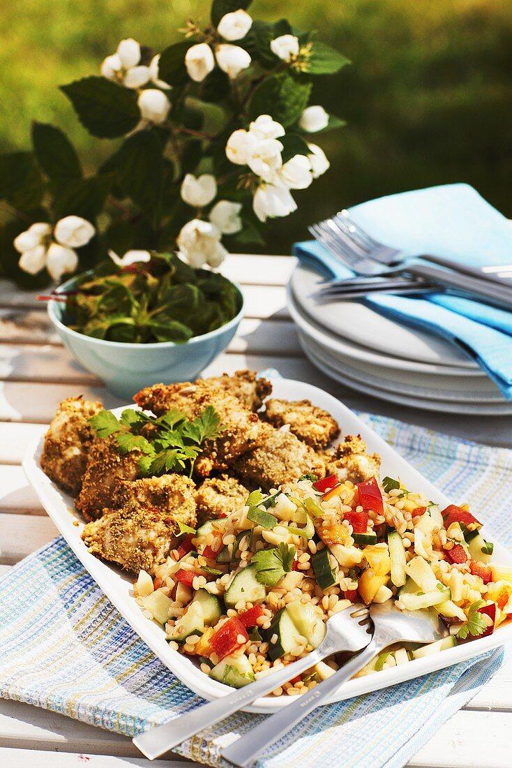 Quinoa salad with chicken nuggets