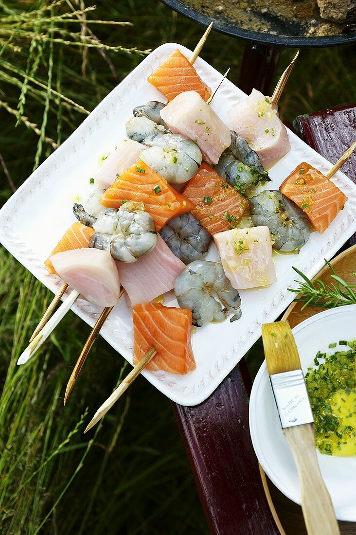 Fish kebabs with herb oil ready for barbecuing