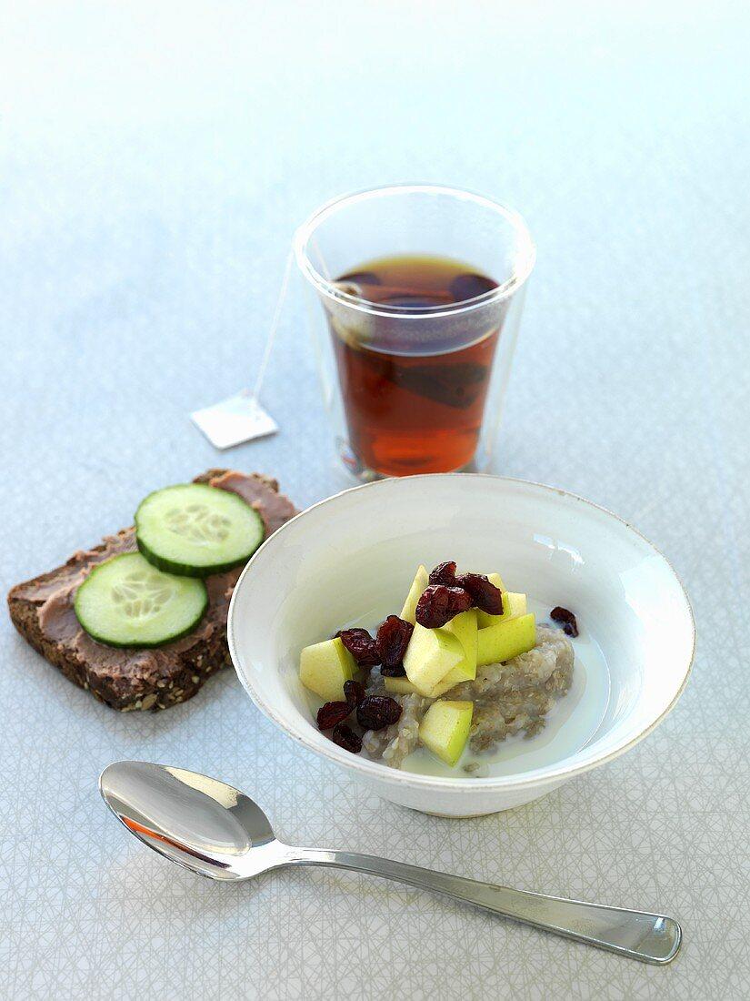 Porridge with fruit, meat paste on bread, tea