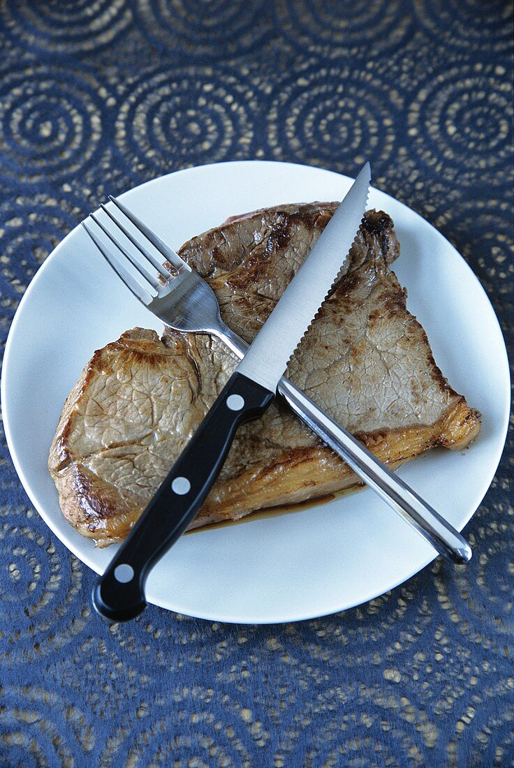 Beef steak with knife and fork