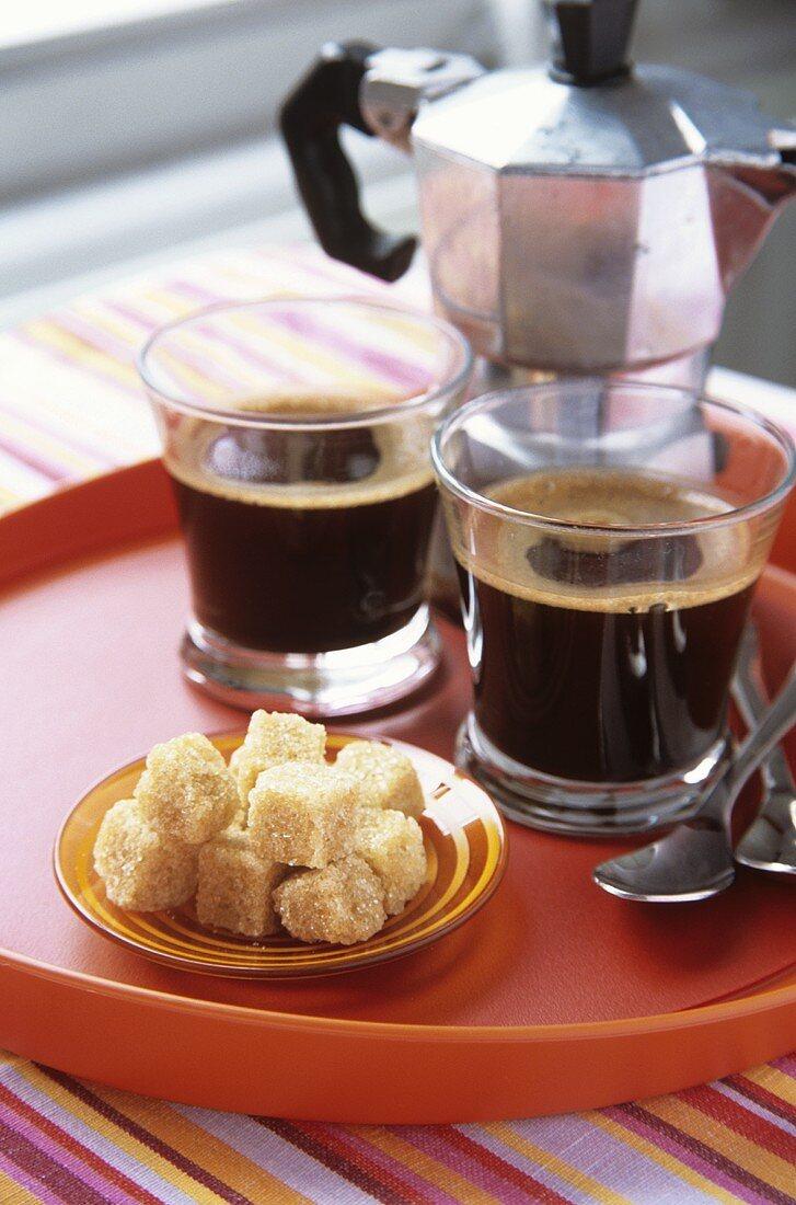 Two espressos, brown sugar and espresso pot