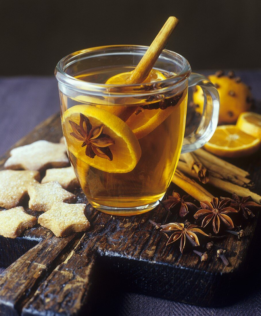 Grog with orange slices and spices, star-shaped biscuits