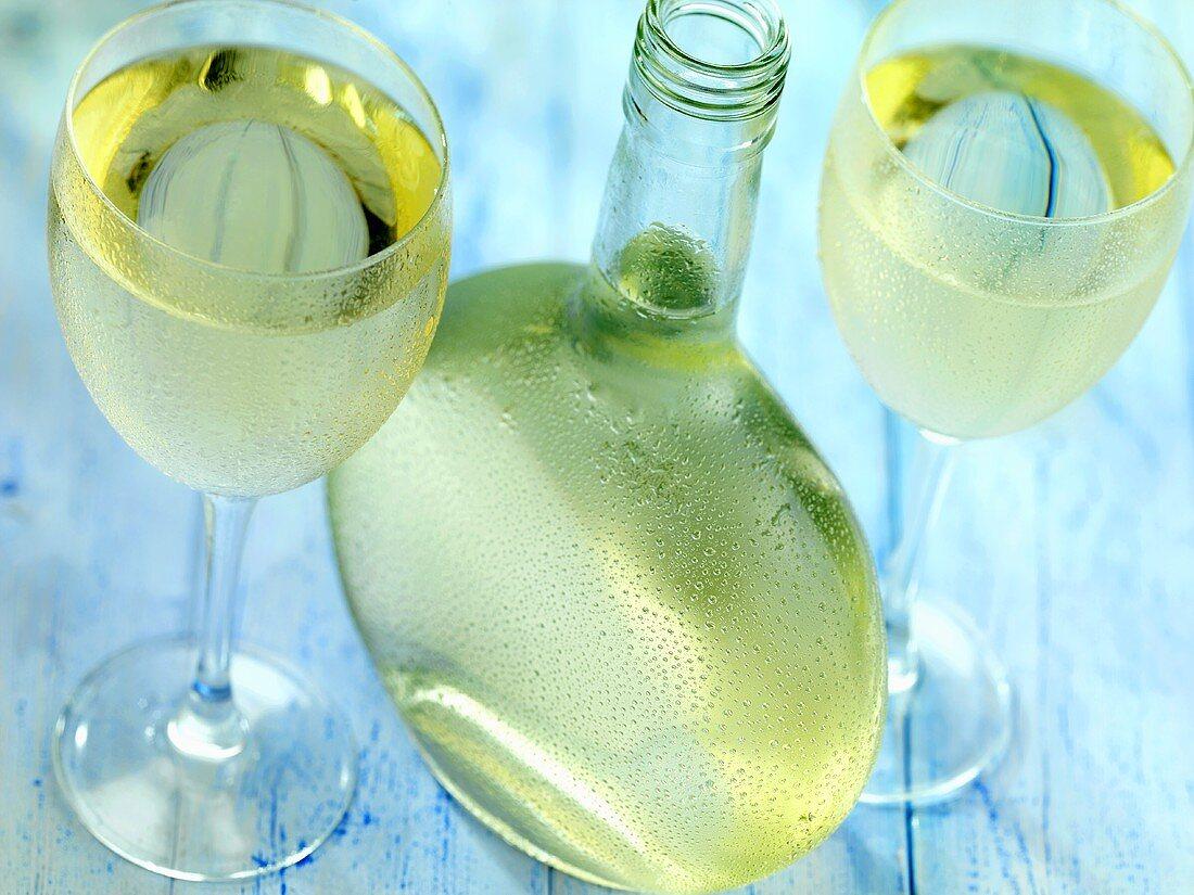 Retsina (Greek white wine) in glasses and bottle