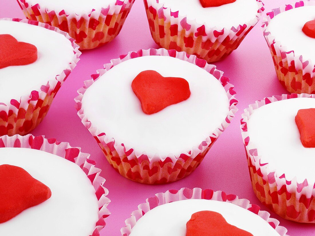 Several cupcakes decorated with marzipan hearts