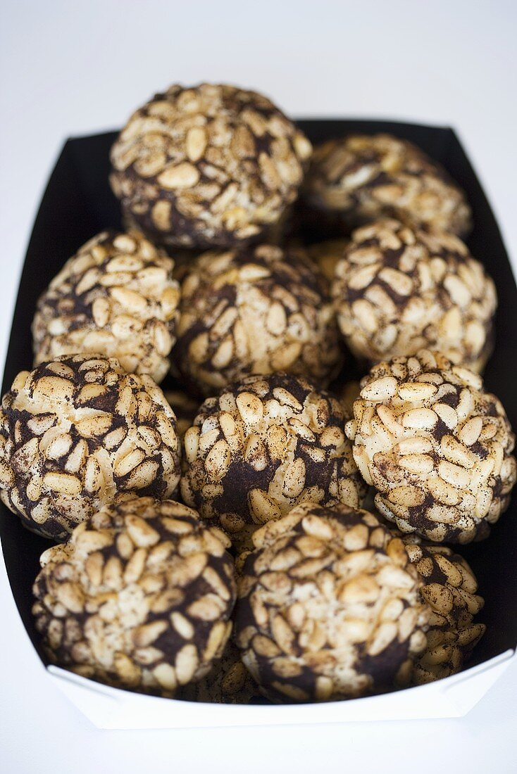 Chocolate balls with pine nuts