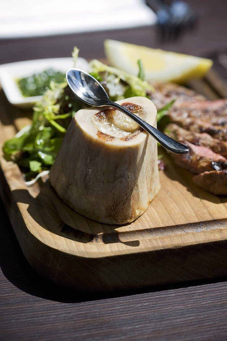 Roasted marrow bone, grilled sirloin steak, salsa verde