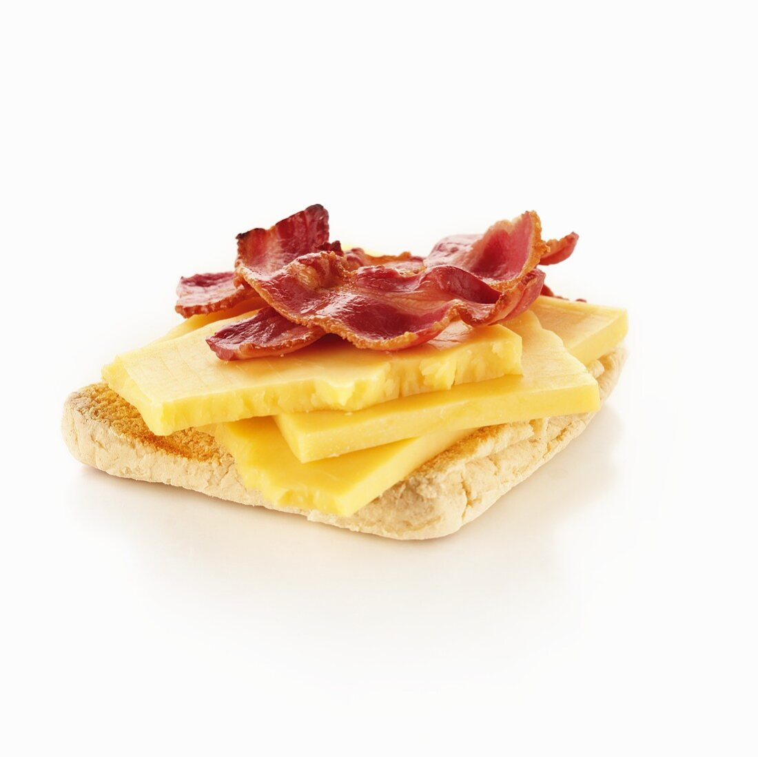 Cheese and fried bacon on English muffin