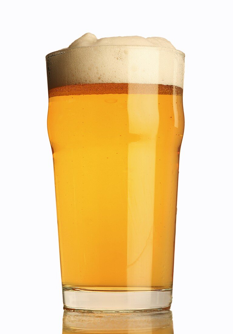 A glass of lager with a head