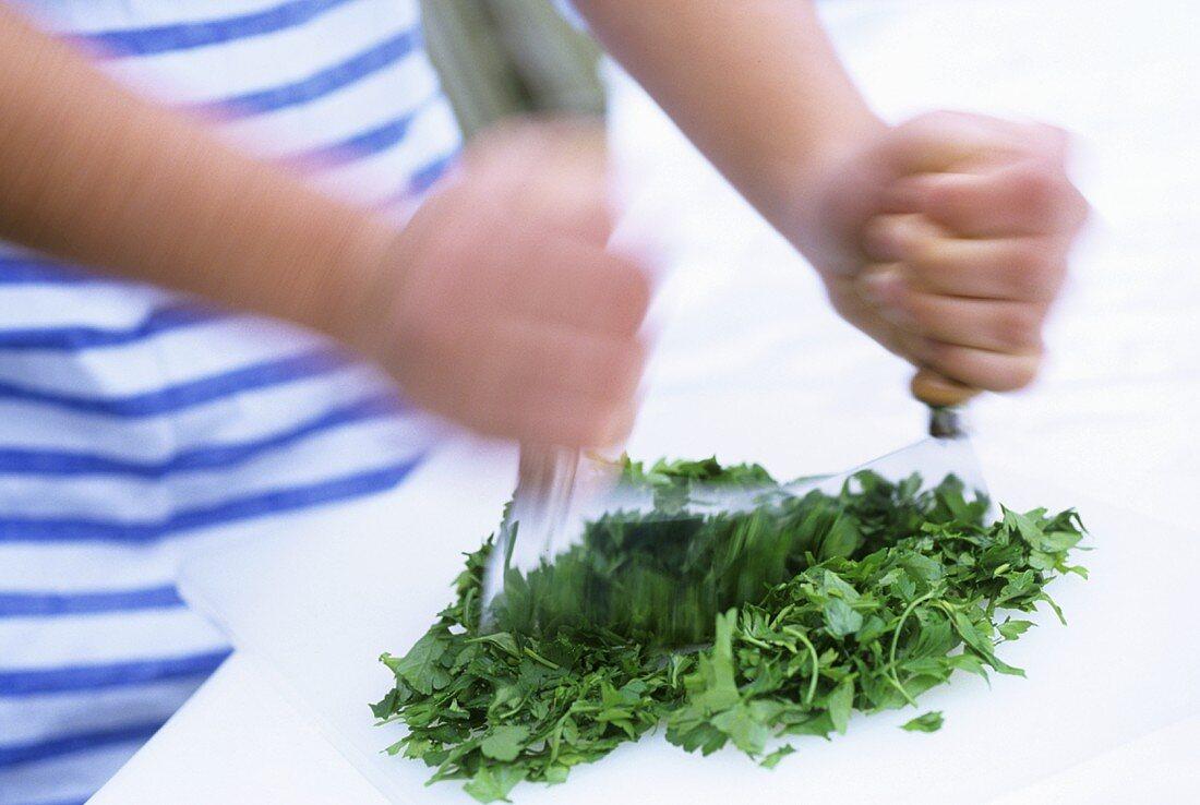Chopping herbs with a mezzaluna