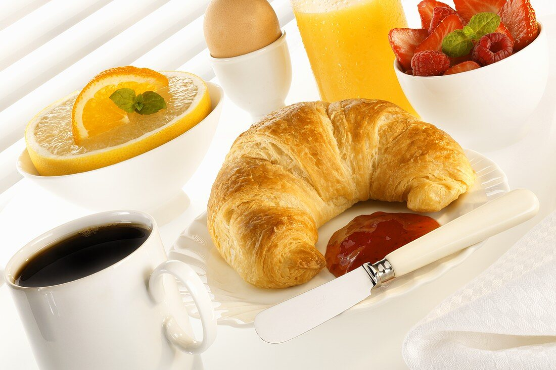 Breakfast: coffee, juice, croissant and fruit