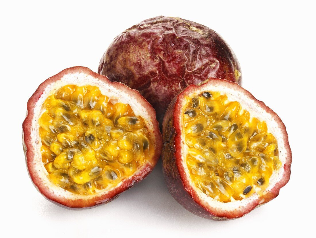 Whole and halved passion fruit