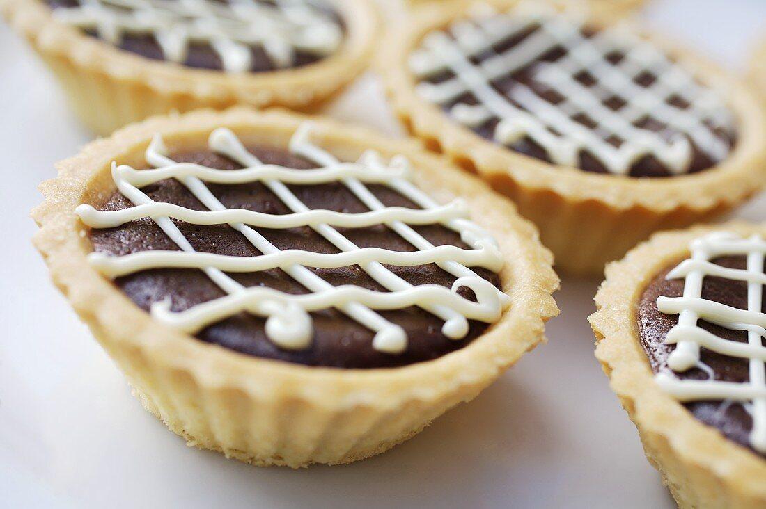 Chocolate tarts with lattice icing