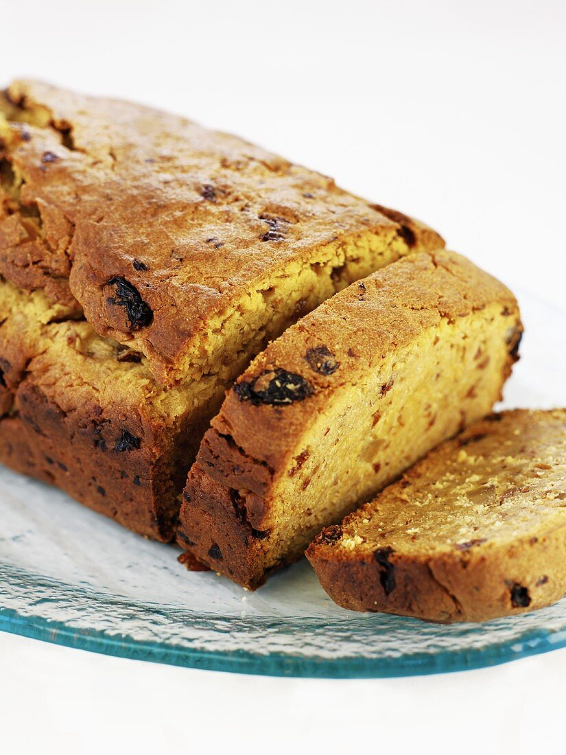Saffron cake with dried fruit, partly sliced