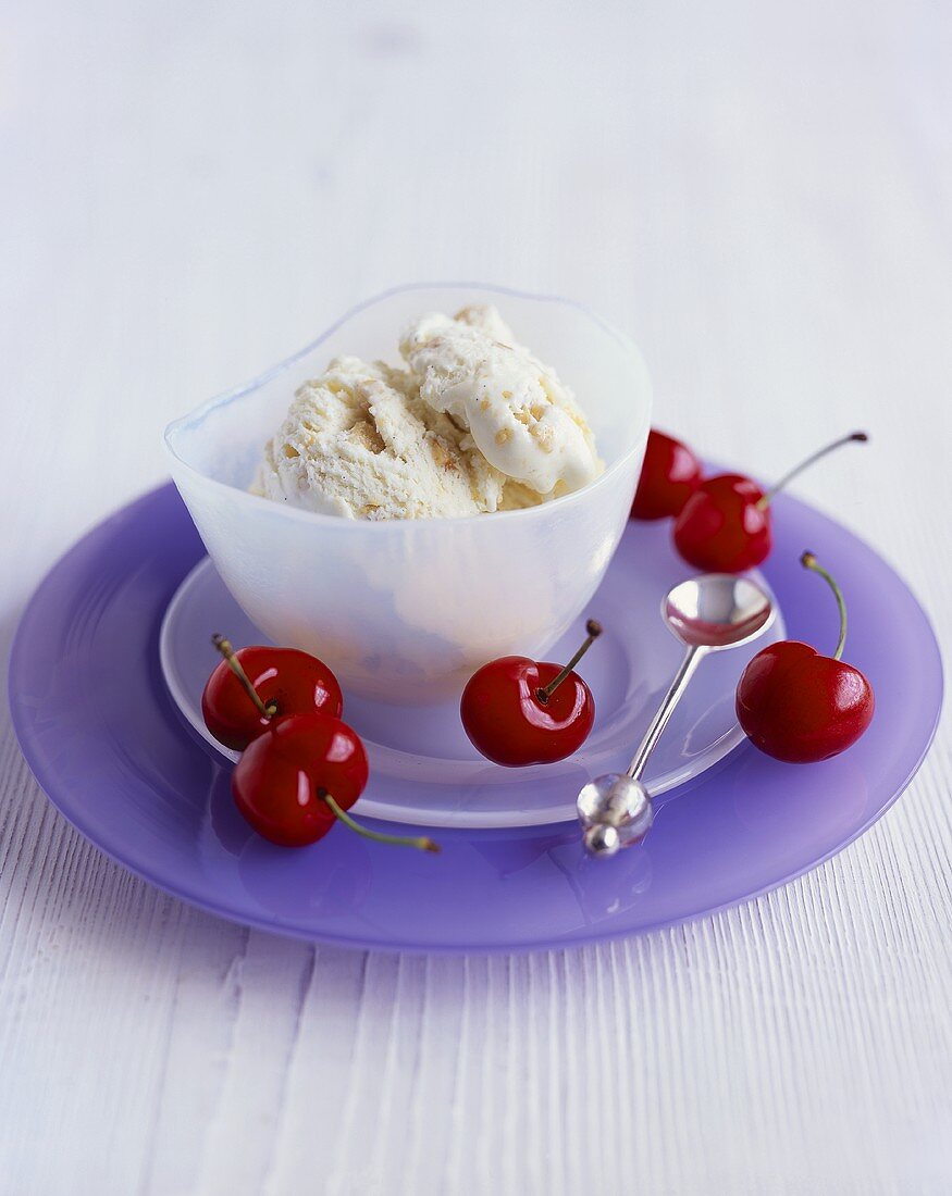 Turron ice cream in a glass bowl with cherries