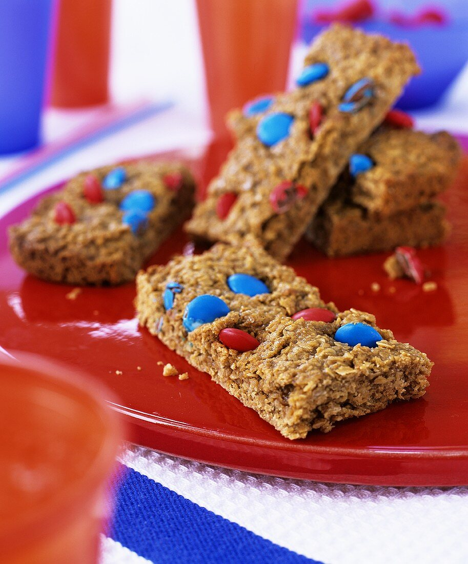 Flapjacks with coloured chocolate beans for children