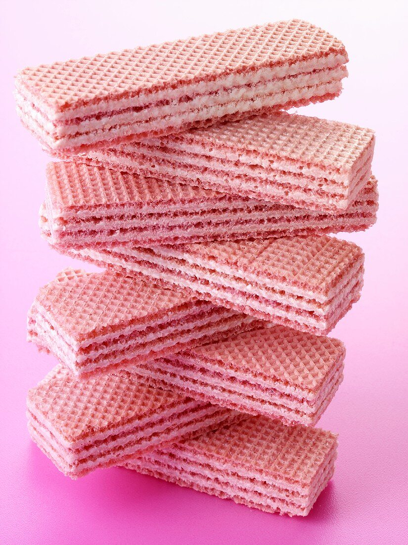 Pink wafer sandwich biscuits, in a pile