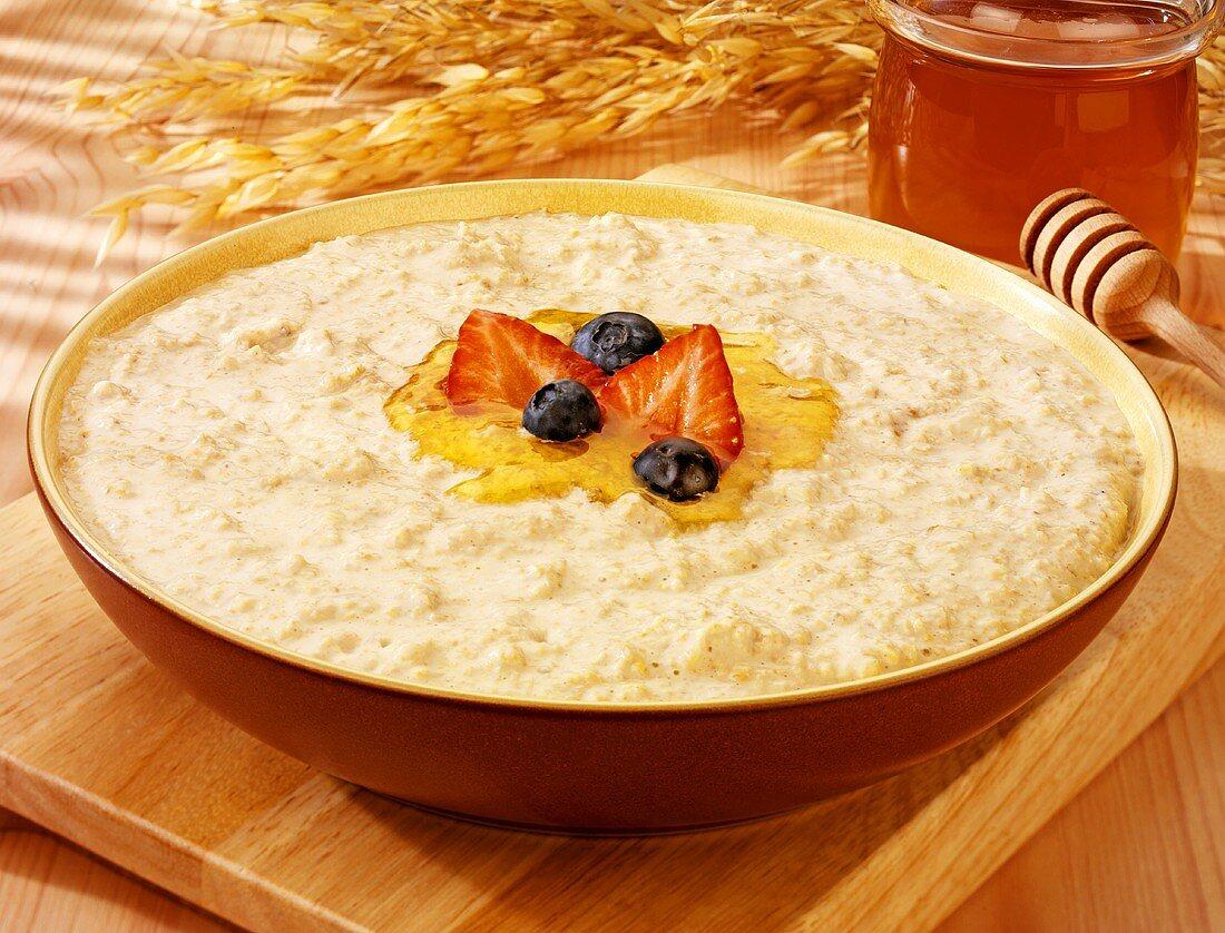 Porridge with honey, strawberry & blueberries, cereal ears