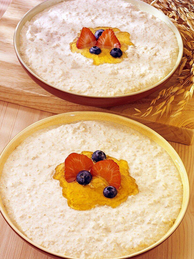 Porridge with honey, strawberries and blueberries