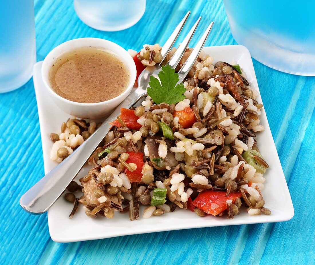 Rice salad with lentils and aubergines, garlic dressing