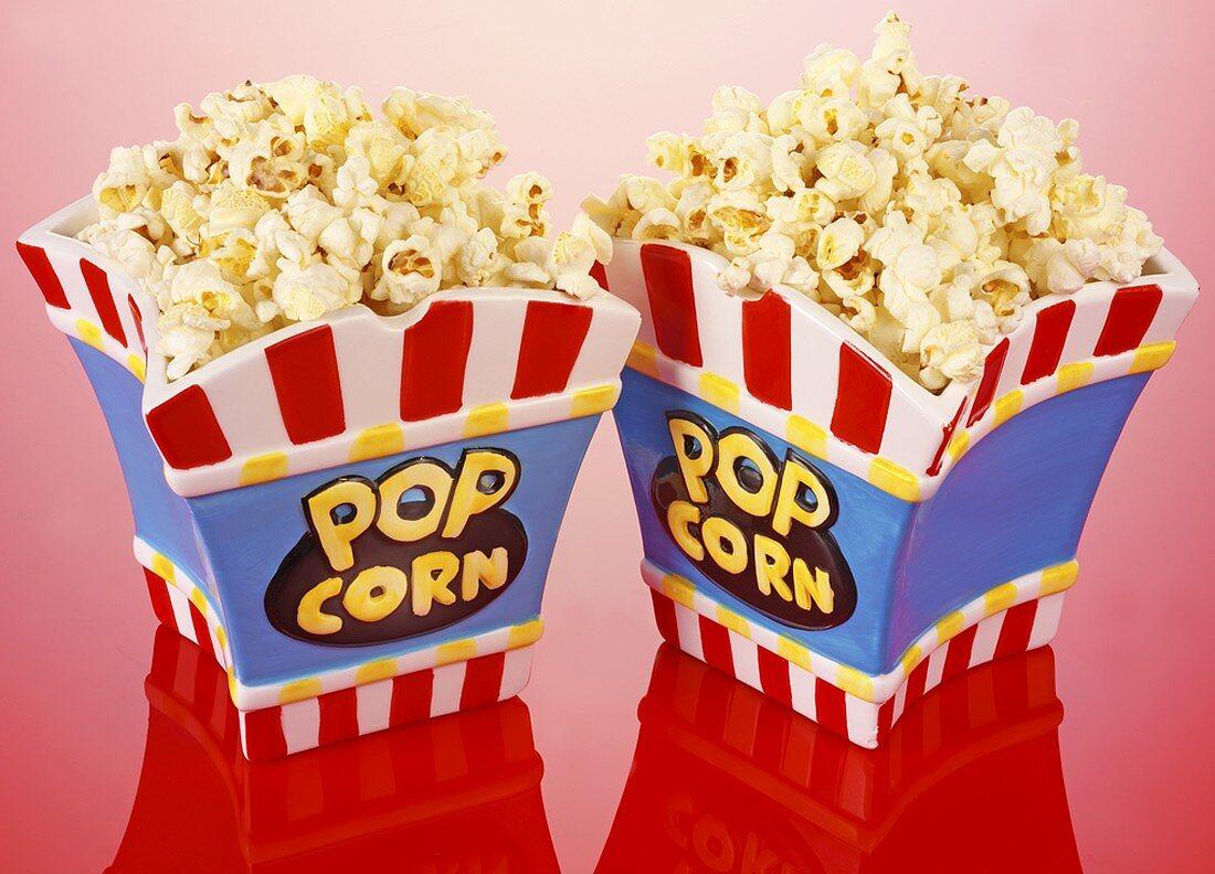 Popcorn in two ceramic popcorn bowls