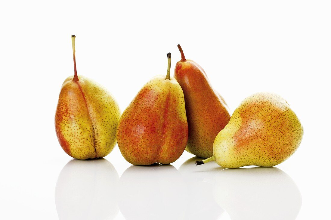 Four Forelle pears side by side
