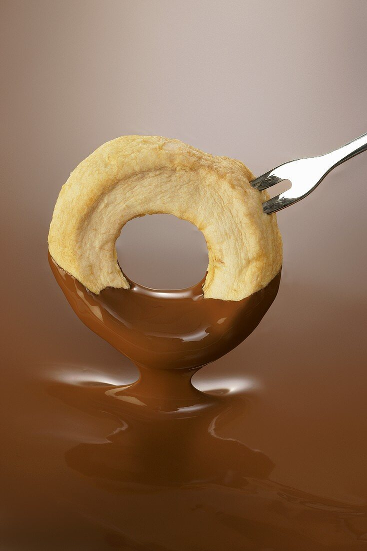 Apple ring in chocolate sauce