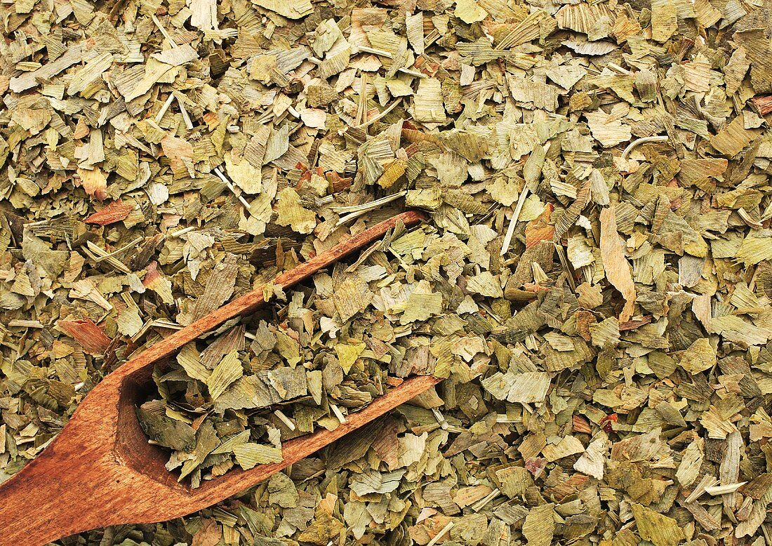 Dried ginkgo leaves with wooden scoop (full-frame)