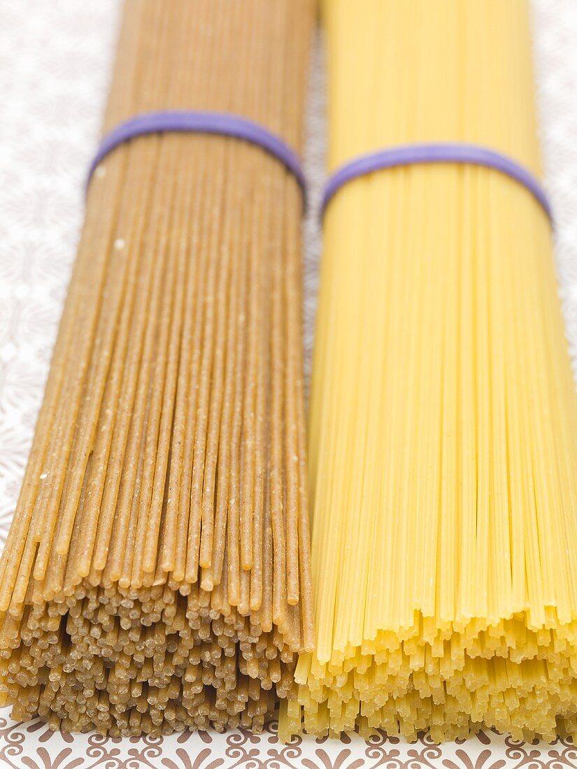A bundle of spaghetti and a bundle of wholemeal spaghetti