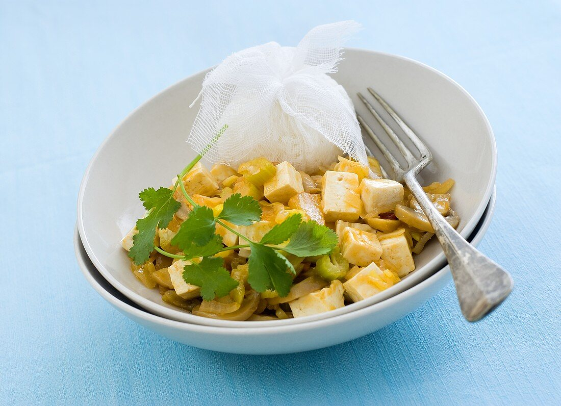 Tofu curry with rice and coriander leaves