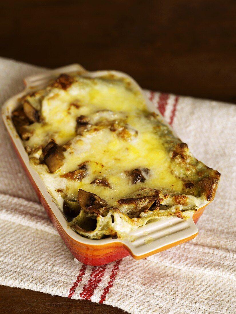 Carrot and mushroom lasagne in a baking dish