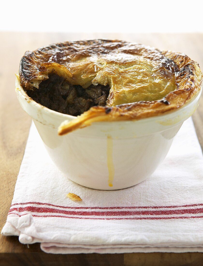 Beef pot pie, a spoonful removed