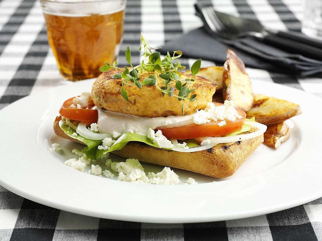 Chicken breast and potato wedges on crusty roll