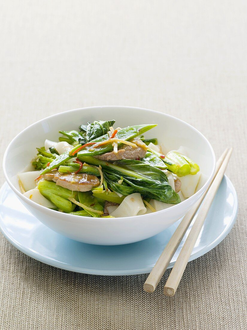 Pork with choy sum (Chinese flowering cabbage) on rice noodles
