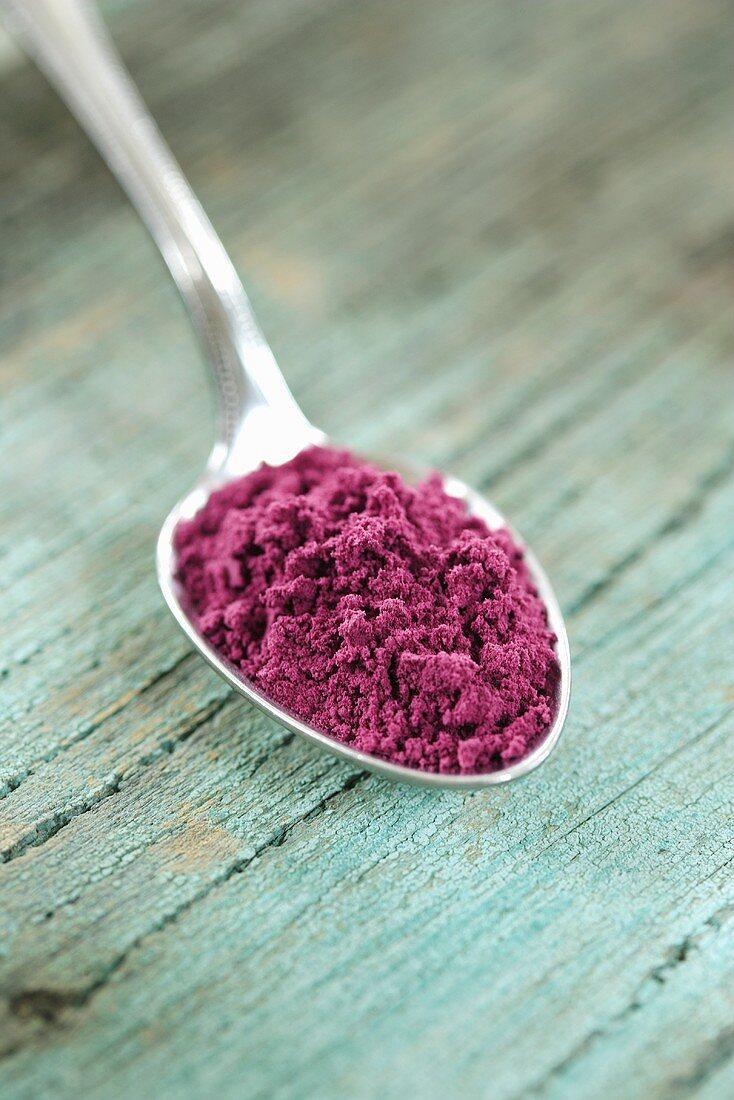 Acai powder (diet aid) in spoon