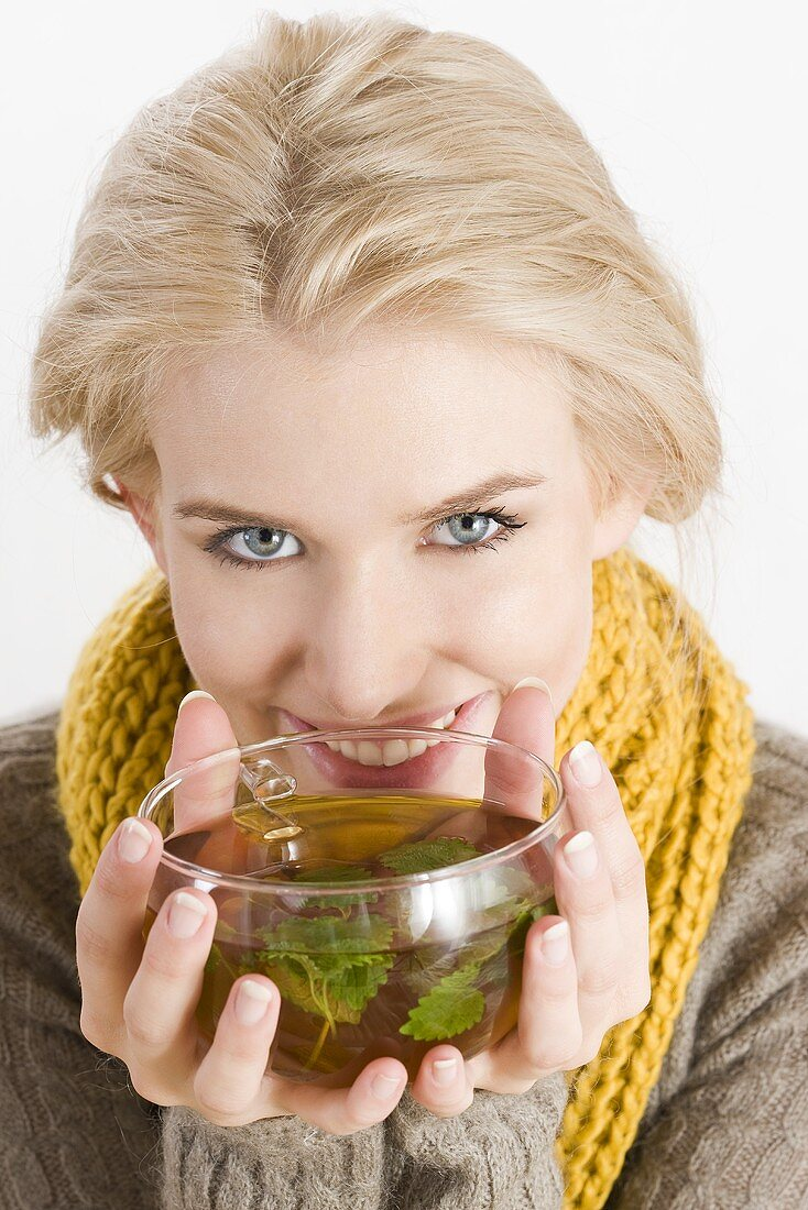 Blond woman drinking herbal tea