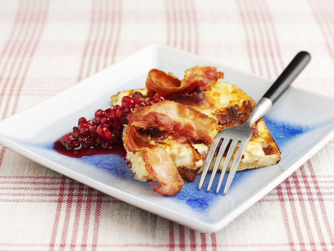 Potato gratin with bacon and cranberry compote