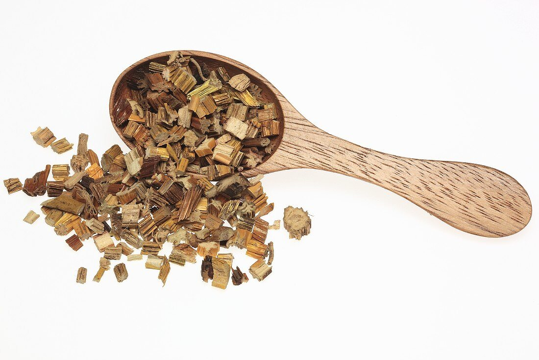 Dried noble dendrobium (Dendrobium nobile, Shi hu) with wooden spoon