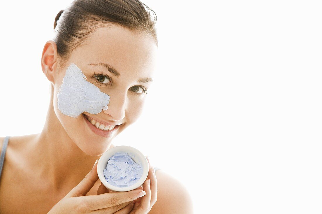 Young woman with blue facial mask