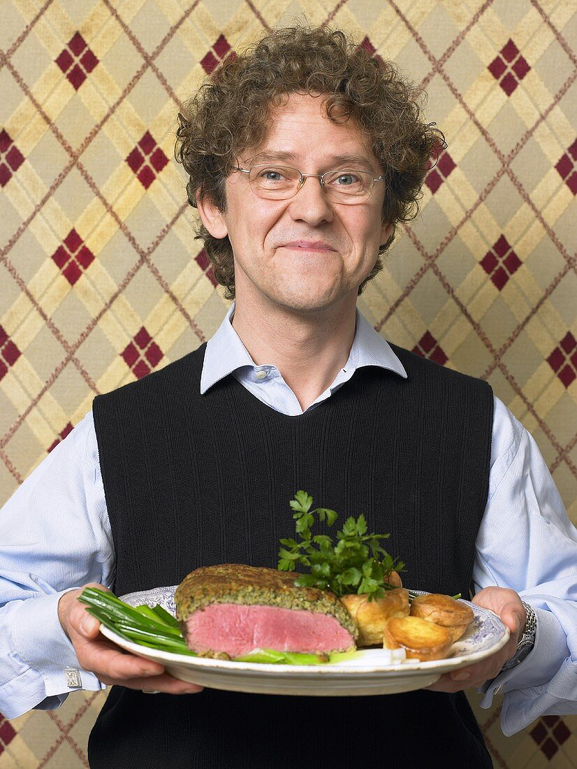 Englishman serving roast beef with Yorkshire pudding